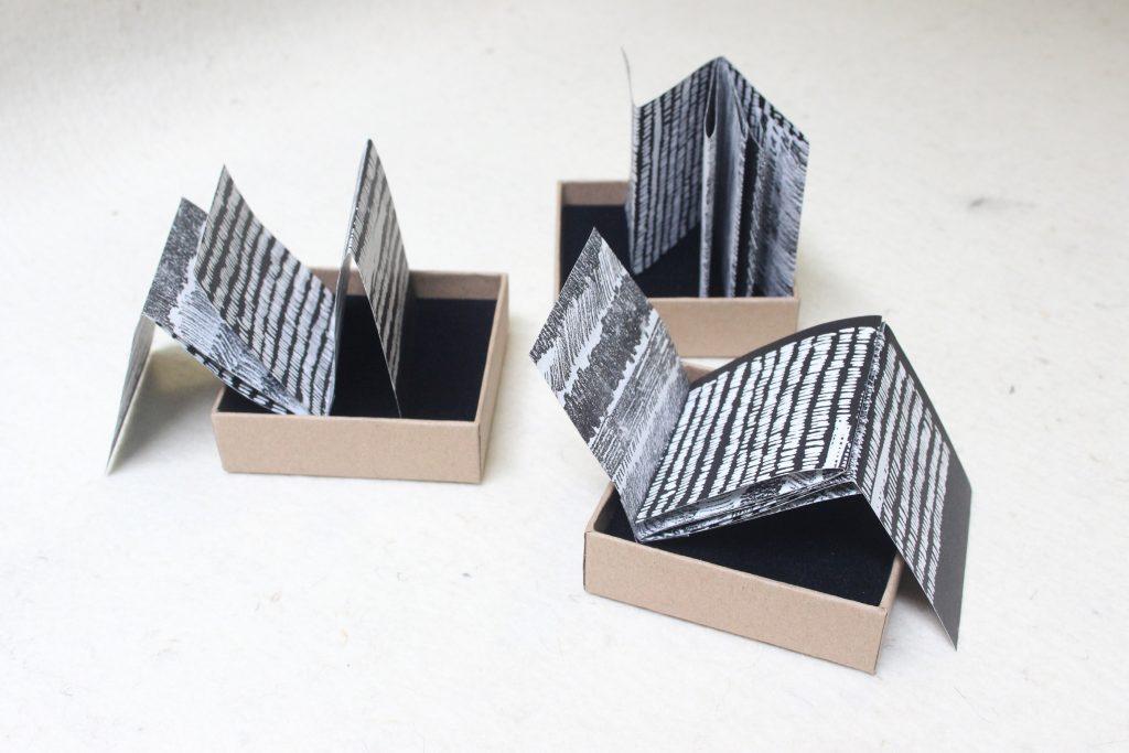 ST/ Serie de tres libros de artista en caja de cartón